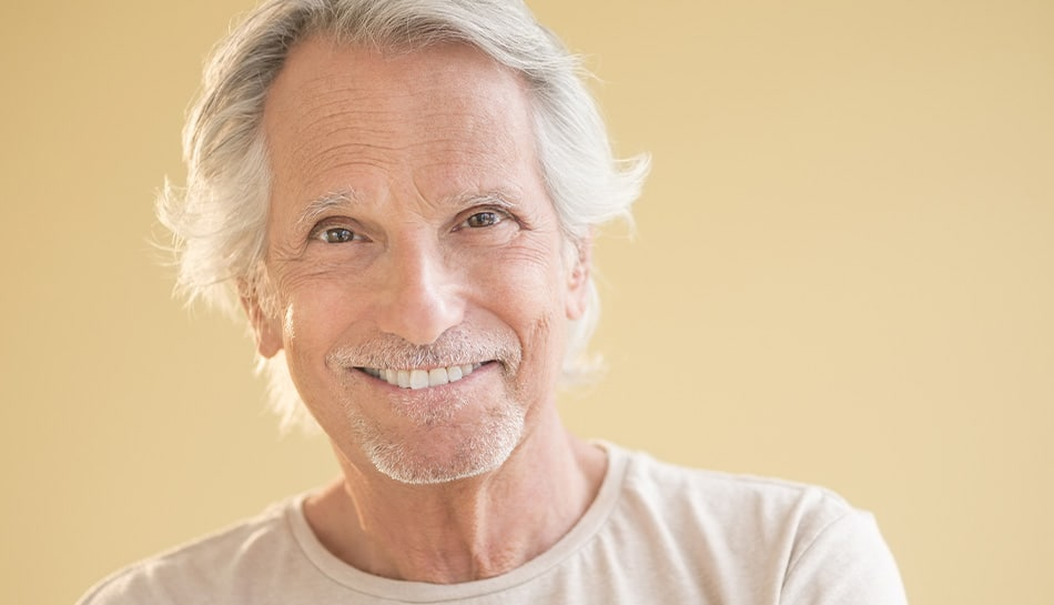 mature man shows off his unique smile