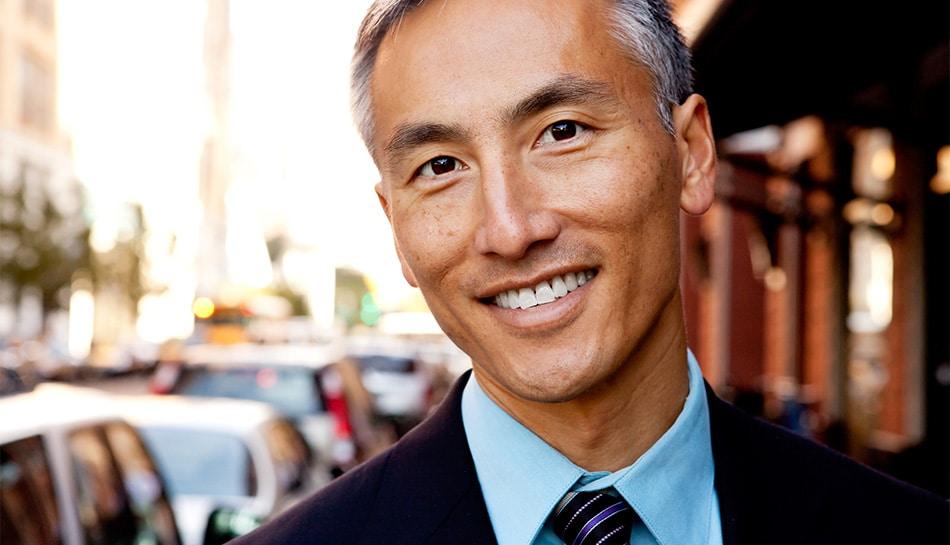 mature Asian businessman on a busy street