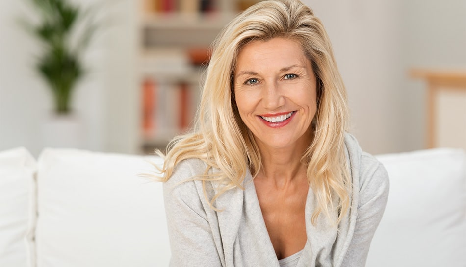 mature woman shows off her beautiful smile